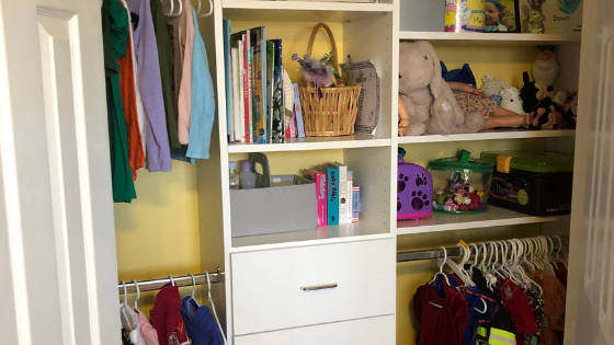 A child's closet organized with tips from Closets by Design.