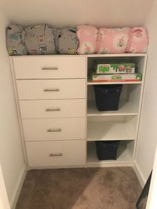 A child's closet organized with shelves and drawers.