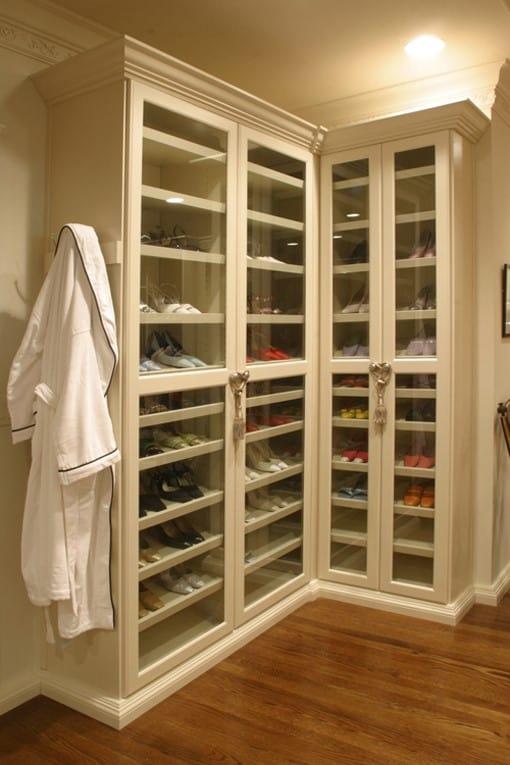 A shoe closet with slanted shoe racks.