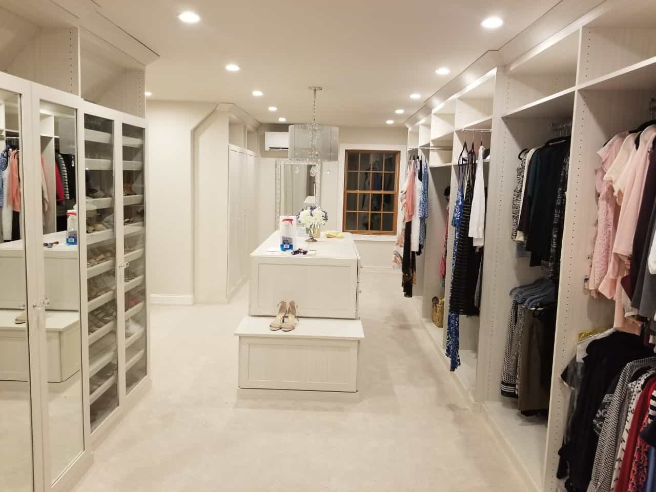 A custom walk-in closet from Closets by Design with island.