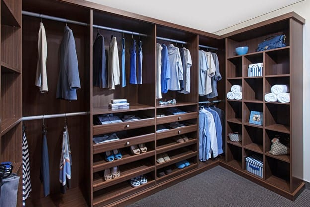 A custom walk-in Brio Collection closet from Closets by Design.